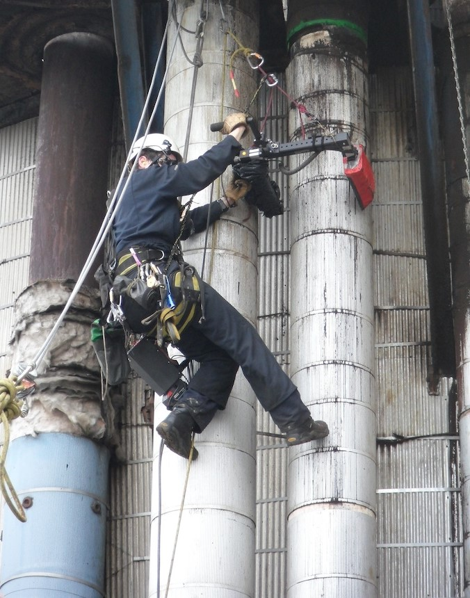 man provides difficult service with the help of rope access